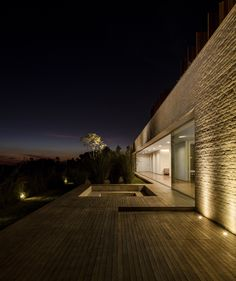 Highlight the texture of a wall by having up lights at the base. Casa m-s, são paulo.