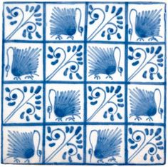 """Swan"" (1880s) tiles designed by William Morris for Morris & Co. Manufacturer is Ravesteijn Tileworks, Utrecht, The Netherlands. Earthenware."