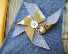 Pinwheel Boutonniere from Rose and Birch. So much better than a flower!
