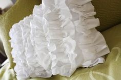 Simple, cheap and cute.  What more can you ask for?    Cascading Ruffle Pillow-favecrafts
