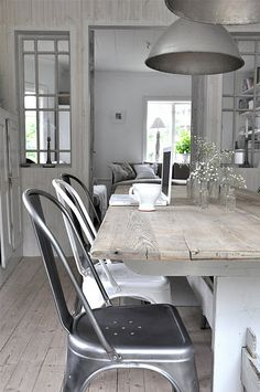 Thinking of refinishing my farmhouse table... Love the driftwood with white and the industrial chairs