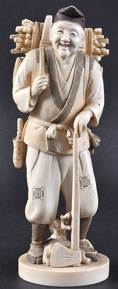 A LATE 19TH CENTURY JAPANESE MEIJI PERIOD IVORY OKIMONO depicting a male carrying lumber. Signed. 8ins high.