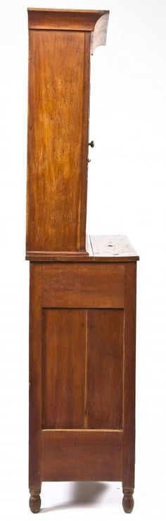 """DESCRIPTION: A pie safe with glazed cupboard probably Dauphin County circa 1860. The form consisting of a double door, punched tin, paneled pie safe with an attached nine light glazed door cupboard over top. Varnished surface, possibly original. There are a small number of single door glazed cupboards on tables that have associations with Dauphin county. This form is very similar and thus may be from the same shop. MEASUREMENTS: 83-1/2"""" x 39"""" x 19"""". CONDITION: Wear consistent with age. Lower…"""