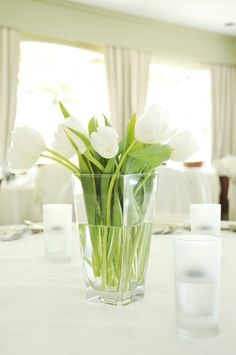 Simple tulip centrepieces. Photography courtesy of Gemini Photography.