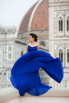 A beautiful cobalt blue gown amongst the rooftops!