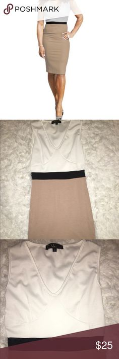 "Sleeveless, V-neck, 3 color bodycon dress. Dress features three colors (white on top, black in the middle, and tan on bottom), and can be worn both day and night. It is not NWT, however it has never been worn (it was received 3 days after I found out I was expecting. Great for ""old me"", not so great for ""baby-growing me""! Ha. Perfect Style Dresses Midi"