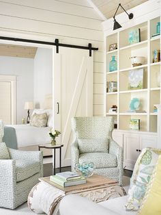 Take Five: A Breath of Fresh Cottage Style...plank walls, barn doors, and bookcases...What's not to love?
