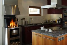 Wood heating stove / contemporary / metal / with cooktop COOKCOOK Rüegg Cheminée Schweiz AG