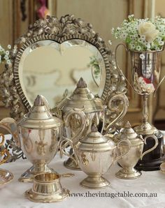 art deco silver tea sets, vintage silver trophy and antique silver Victorian heart shape mirror│The Vintage Table - FB
