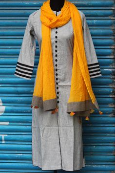 Buy Maati Crafts Gray Cotton Solid Straight Kurti online in India at best price.grey mangalgiri kurta, with black trims on sleeve and potli buttons in black. to complete this look, Kurti Designs Party Wear, Dress Designs, Blouse Designs, Plain Kurti, Kurta Patterns, Simple Kurti Designs, Pakistani Dress Design, Pakistani Dresses, Churidar Designs