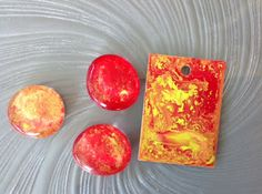 """I've started experimenting with """"dirty pours"""", and I think that I'm in love!!!! They're so much fun, that I'm sure it will become yet another fascinating addiction for me (heh, heh, and perhaps for a few others)! ! As I mentioned in an earlier blog post, you could use either resin or acrylic pouring medium, as the base of your pours. I used pouring medium this week, but I do promise to work with Ice Resin next time. The small measuring cups were overkill, as no measuring was required with…"""