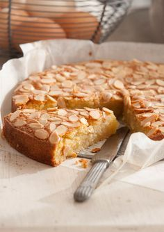 Flourless Coconut & Vanilla cake (Belinda Jeffery) Whats appealing is that it only takes about 15 minutes to make and is wonderfully versatile  perfect for afternoon tea but serve it with poached plums quince or tamarillos and a dollop of rich cream and its like waving a magic wand that transforms it into a very elegant dessert.