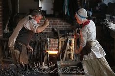 The blacksmith at the Armoury at Colonial Williamsburg. Photo by David M. Doody - Note the woman who is also working at the forge; tradeswomen were a part of reality in the 18th century, when all hands were needed to help the family to make ends meet.