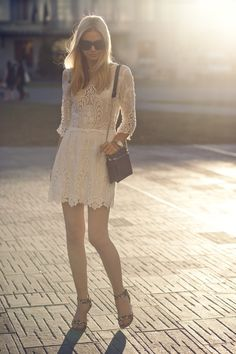 Jess from Tuula Vintage looks amazing in this white lace Dolce Vita dress.