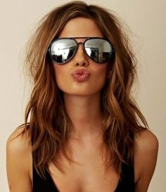 Mid- length brown hair with Carmel blending highlites. Color at the base can be warmer (more red) also.