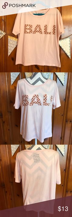 "Oversized Boxy Bali Tee Cute, super soft, and comfy this tee shirt has it all. Light pink with ""Bali"" written in a light brown. This is an oversized boxy tee, and can be worn off the shoulder with a tank top underneath. Slight pilling throughout from washing (see close up pic). Otherwise, excellent condition. This shirt was purchased looking soft and worn.  23"" Bust (armpit to armpit) 24"" Long Tops Tees - Short Sleeve"