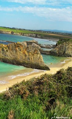 The nudist beach of Mexota in Asturias, Spain. A splendid beach with the most peculiar rock dividing it.