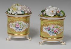 A pair of Lynton porcelain cylindrical bough pots and covers