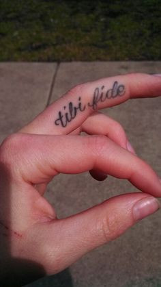 "My finger tattoo- tibi fide, Latin for trust yourself.  actually thats latin for ""you the faith"" trust yourself in latin is ""confidis teipsum"" which would make an equally cool tattoo."