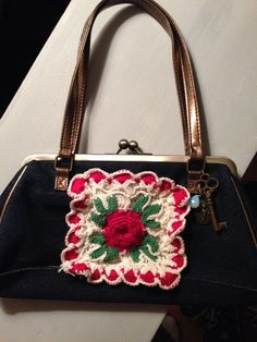 Vintage inspired hand bag with hand made doily and charm accents.