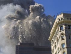 At 10:28 a.m., after burning for 102 minutes, the North Tower of the World Trade Center collapses on September 11, 2001 in New York City. (A...