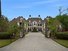 Timeless architectural design in this supremely elegant French Country-inspired estate home, exuding symmetry & art with gated, circle driveway, verandas, and an oversized 2+2 garage! The Woodlands, TX Coldwell Banker United, Realtors $2,350,000