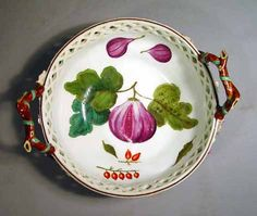 A Chelsea Porcelain Reticulated Circular Basket,  Probably James Giles decoration,  Circa 1755-60. The circular baskets with brown twig handles terminating in leaves and flowers has a border of openwork, the rim painted in brown.  The interior of each basket is painted with fruit and leaves.  The exterior of the basket with a moulded basket weave pattern with openwork to top edge.