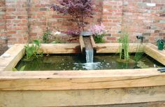 raised water garden with Japanese style water spout