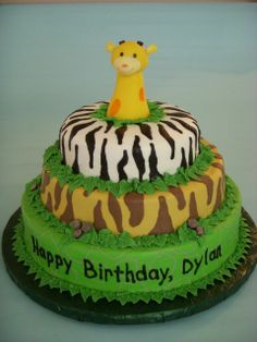 Animal print giraffe cake - This was made to look similar to a stacking toy the mom was using as a theme for the party.  It has alligator, tiger and zebra prints piped onto the buttercream, and the giraffe is fondant.