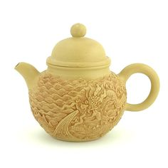 yixing embossed dragon teapot ... with design of dragon and waves, yellow, with dome lid, clay stoneware, China