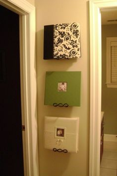 Use plate hangers to display photo albums on the wall so you, friends, and family, can enjoy them more often. Cute idea :)