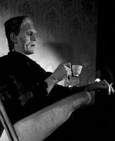 Frankenstein's monster (Boris Karloff) enjoying tea and a cigarette