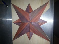 Compass rose layout for reclaimed pallet table top