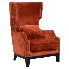 Bring eye-catching style to your living room or study with this lovely wingback chair, featuring burnt apricot upholstery and classic nailhead trim....