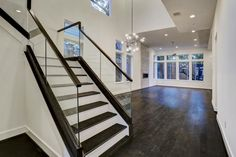 2314 Elmen St Houston, TX 77019: Photo Stunning Staircase with Oak Treads, Interior Glass Railing with a Stained Wood Hand Cap and Base.