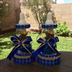 Royal blue and gold baby shower centerpiece 10 tall Comes with a plastic bottle and a baby inside decorated with a foam crown. The bottom is a