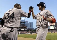 Boston Red Sox's David Ortiz (34) high-fives Kevin Youkilis after Youkilis hit a solo home run in the fourth inning of?a baseball game against the Baltimore Orioles in Baltimore, Tuesday, May 22, 2012. (AP Photo/Patrick Semansky)
