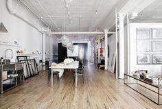 Contemporary Modern Scandinavian Retail Store Design: Hardwood flooring in an industrial-style open-plan loft's dining area.