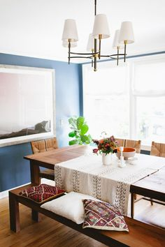 bohemian global style dining room with blue walls // coco+kelley