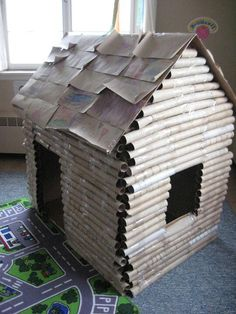 Paper towel roll log cabin... But do I have the patience to save all of these paper towel rolls?