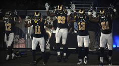 Five St. Louis Rams players entered the arena on Sunday with their hands up, presumably in solidarity with Ferguson protesters.