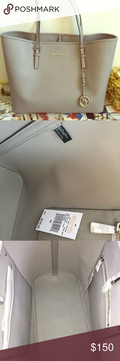 "Michael Kors Pearl Grey Tote NEW WITH DEFECT. THE DEFECTS ARE THE TINY FAINT MARKS ON THE OUTSIDE INDICATED IN YELLOW ARROWS BARELY NOTICEABLE  DIMENSIONS: 18"" wide 11"" height Michael Kors Bags Totes"