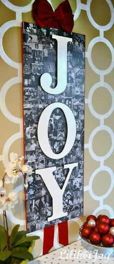 NOW I know what to do with all those OLD christmas foto cards people send & I just cant throw out <3    JOY Holiday Photo Collage- this is too sweet! Great way to display Christmas photos! #12daysofchristmas