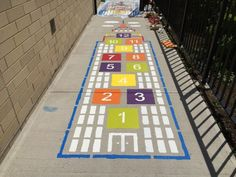 Skyscraper Hopscotch- Climb your way to the top of this retro-cool skyscraper. Hop from space to space using a marker to toss and collect. Hopscotch games strengthen balance and endurance and the use of numbers reinforces mathematical skills. Outdoor Playground, Hopscotch, Retro, Playroom, Skyscraper, Stencils, Outdoor Blanket, Cool Stuff, Therapy Ideas
