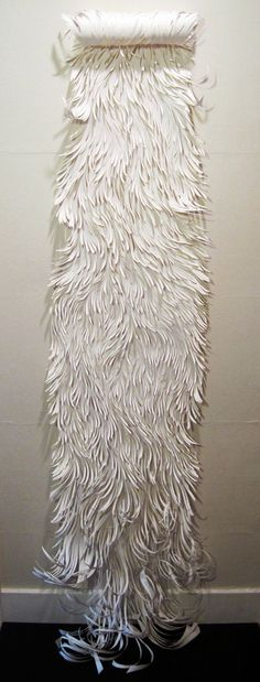 lnop:    Sharon Arnold's paper cut artNixe, 2010 (drawing roll, 6' tall)