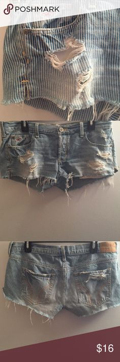 Hollister Distressed Denim Pinstripe Short Hollister Size 7 (28 waist) Only worn a couple times, but look amazing in the summer! Especially with a tan 😉 Bottoms of shorts are frayed by design along with fashionable distress tears on the front of legs and back pocket. The pocket material goes down lower than the shorts for a cool cut-off look. Less on Ⓜercari Hollister Shorts Jean Shorts