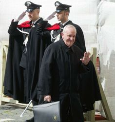 Simple clothes for a simple man of God: Cardinal Bergoglio waves Monday before the conclave that chose him Pope