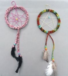 Dream catchers made from plastic lids. Great boho trend piece.
