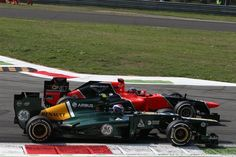 Vitaly Petrov (RUS) Caterham CT01 and Timo Glock (GER) Marussia F1 Team MR01 battle.  Formula One World Championship, Rd 13, Italian Grand Prix, Race, Monza, Italy, Sunday, 9 September 2012
