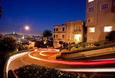 Lombard Street in San Francisco overlooking the Coit Tower and Bay Bridge.